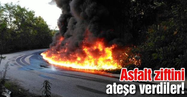 TIR parkı yoluna dökülen asfalt ziftini ateşe verildiler