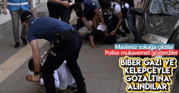 Maskesiz sokağa çıkıp polise mukavemet gösterdiler