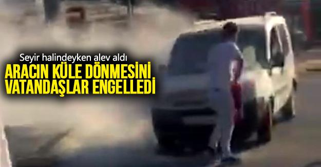 Aracın küle dönmesini vatandaşlar engelledi