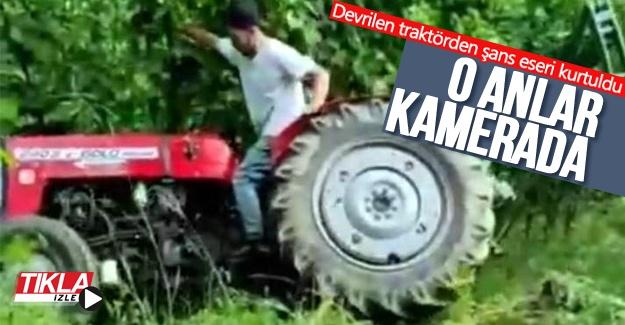 Devrilen traktörden şans eseri kurtuldu