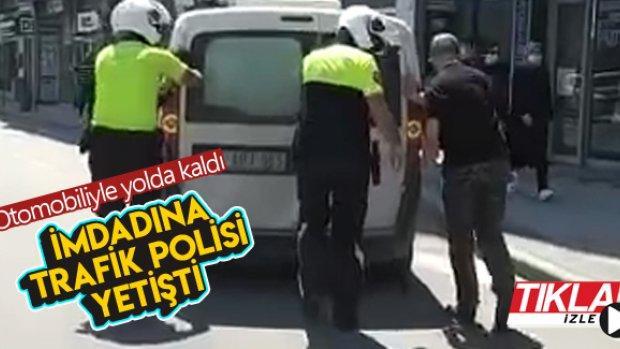 Otomobiliyle yolda kalan sürücünün yardımına polis yetişti