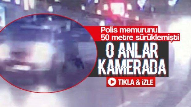 Polis memurunu 50 metre sürükledi
