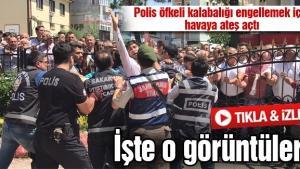 Polis öfkeli kalabalığı engellemek için havaya ateş açtı